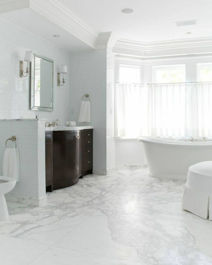 White Floor as an Exquisite Decoration Idea for Modern Interiors. Bathroom with vanity as the only dark accent
