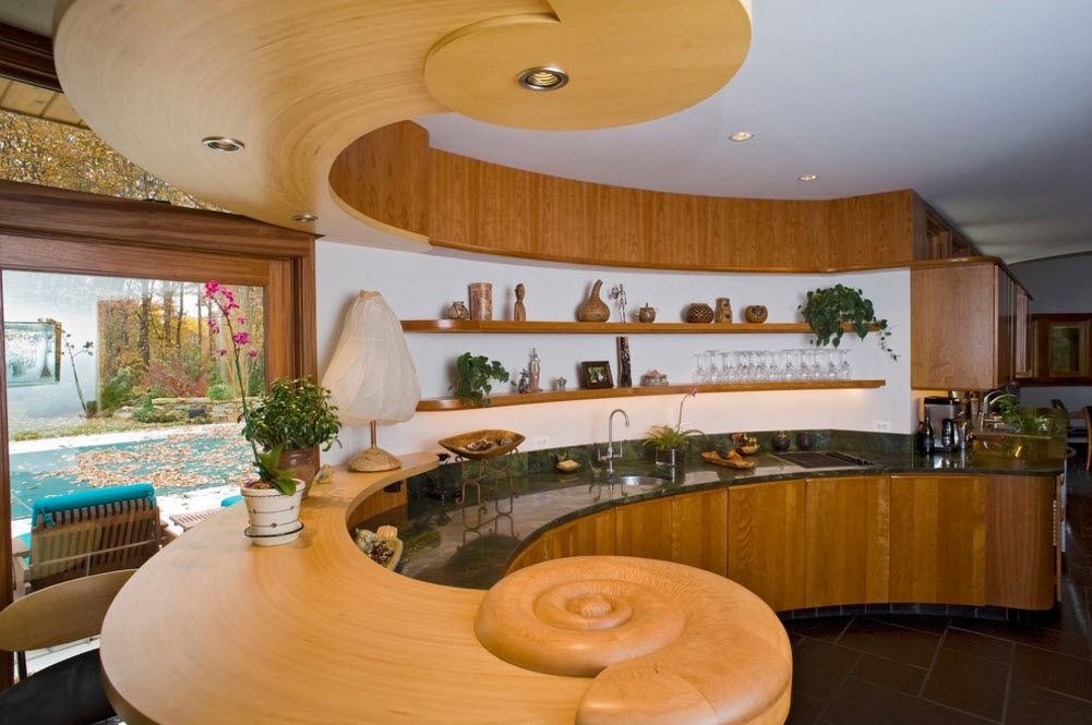 Unbelievable curls and swirls in the design of the light wooden kitchen