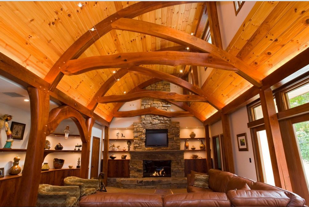 Open ceiling beams in the large premises of the living room with hearth