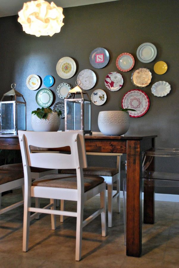 Decorative Plates on the Wall of the Dining room. Colorful accent on the dark beige wall