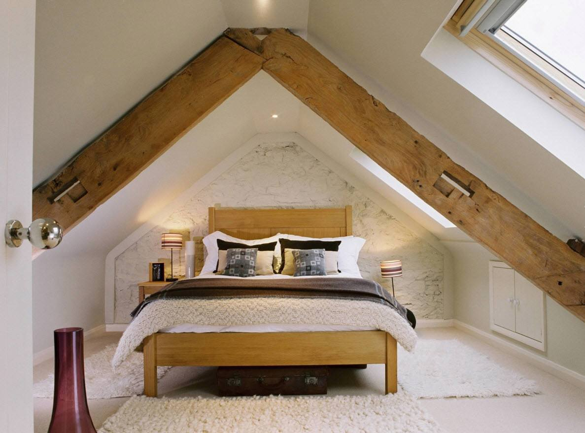 Loft Style Bedroom Design at the Attic. Large massive ceiling beams with built-in stuff
