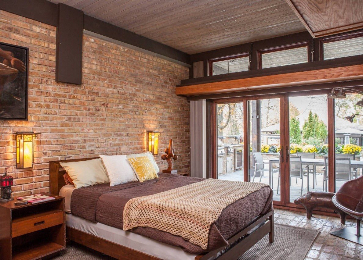 Panoramic window pane in the loft styled mens' bedroom