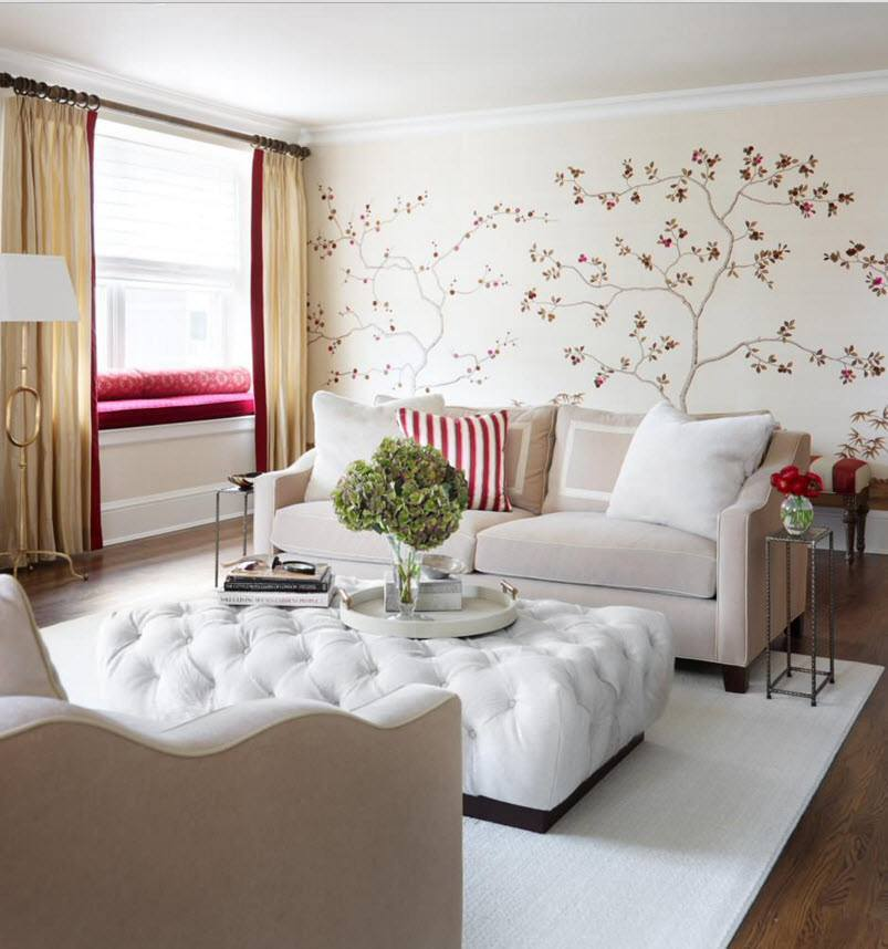 Gorgous fresh naturalistic design of the living with the ottoman and blooming tree print at the wall