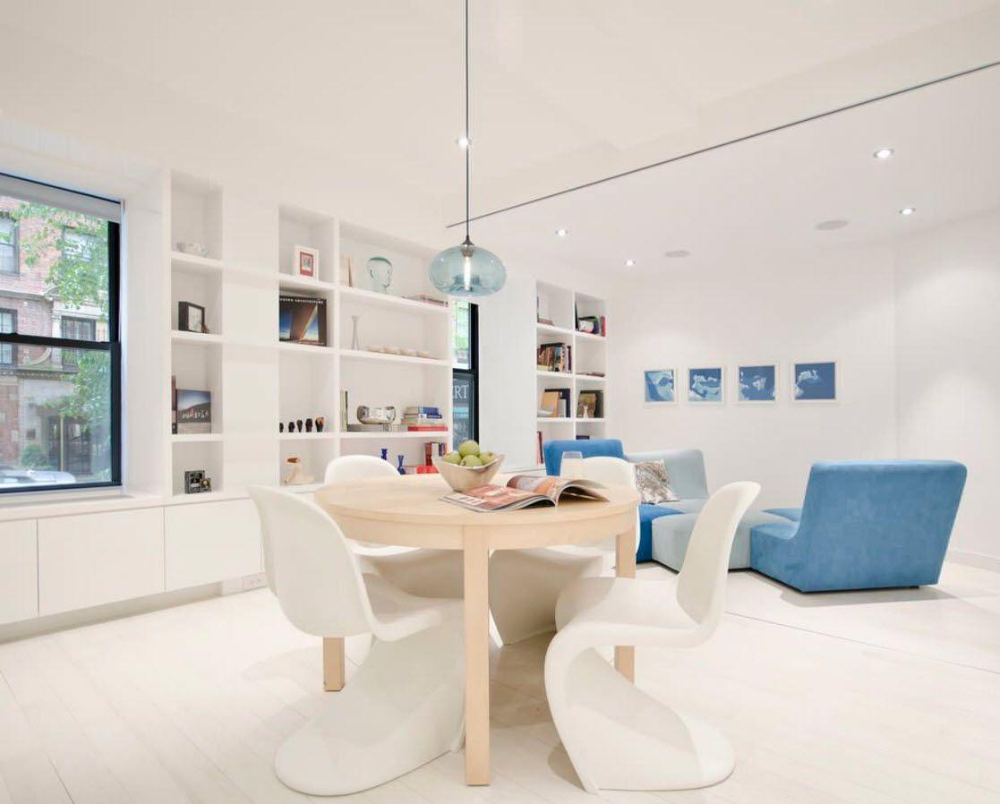 White and blue shades to trim contemporary living room