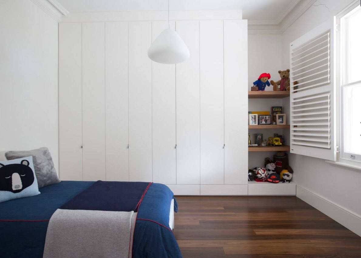 Boy's Room Design Ideas for every Age and Situation. White solid storage with the opening doors