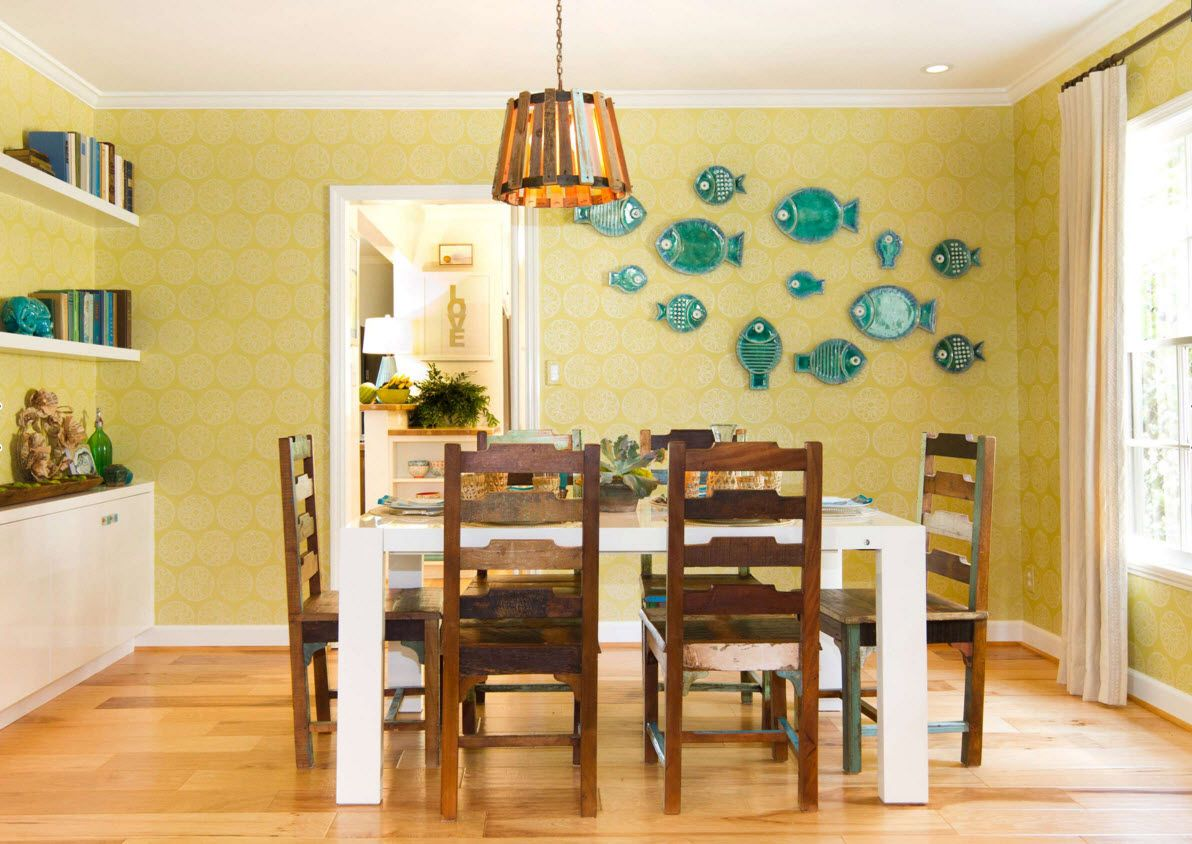 Decorative Plates on the Wall of the Dining room. School of fish on the wall in front of the table will surely rise the appetite