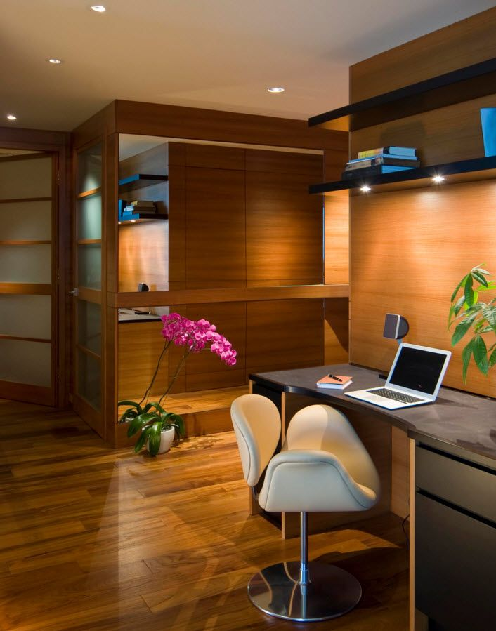 Walnut Furniture for the Modern Interior Decoration. Cozy design of the modern home office with wooden trim