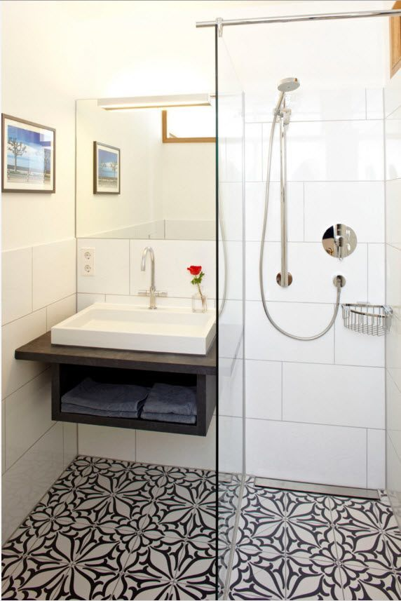 Small Apartment Light Color Design Theme. Natural Separated bathroom with classic style decoration and small contrasting vanity