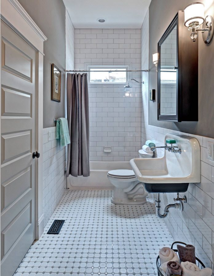 White industrial bathroom interior trimmed with metro tiles
