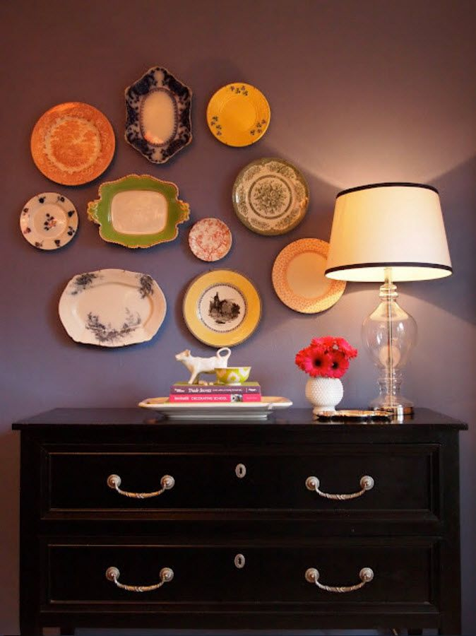 Nice plates collection above the chest of drawers шт the corridor