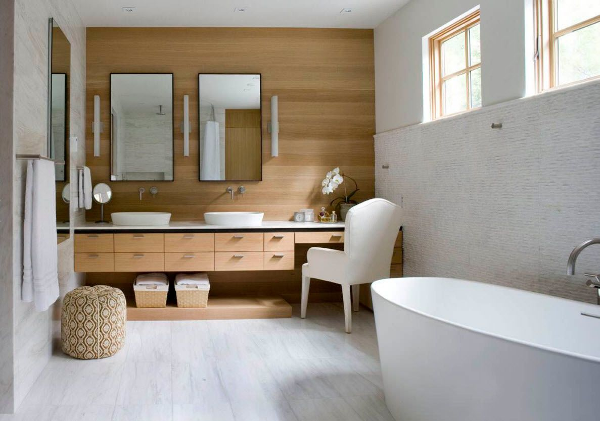 Originally decorated bathroom with the wooden accent wall and white overall decoration