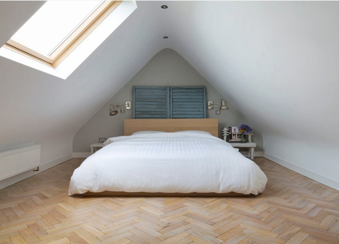 Loft Style Bedroom Design at the Attic. Light sloped ceiling