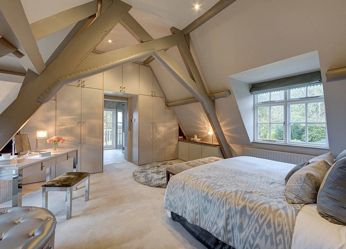 Loft Style Bedroom Design at the Attic. Pastel light tones in the  classically decorated room
