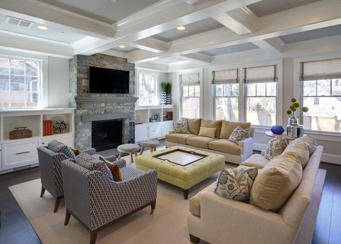 Nice white trimmed living room with the fireplace and accent mango ottoman