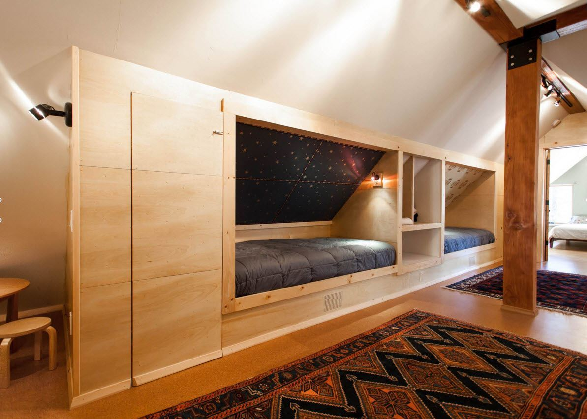 Loft Style Bedroom Design at the Attic. Furniture set with a couple of bearthes