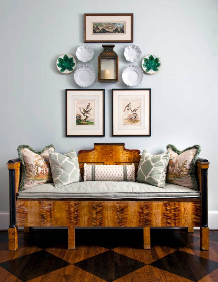 Living Room Wall Plates Decoration. Classic compostition of wooden soft bench, pictures and plates