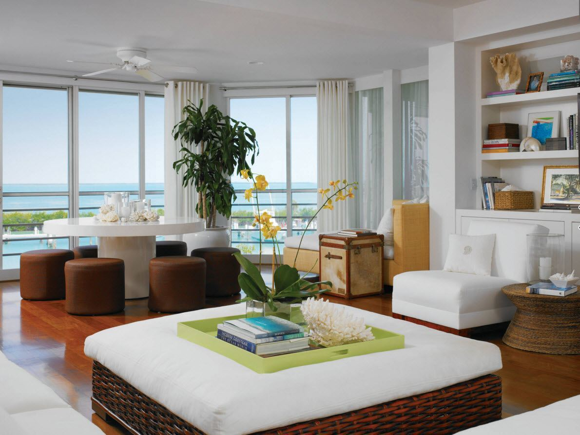Ottoman as the Part of Modern Interior Design. White waterfront apartment with lightweight furnishing