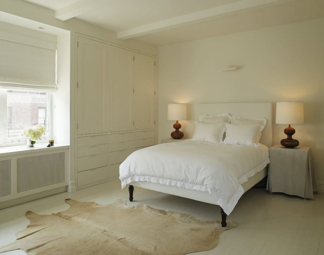 White Floor as an Exquisite Decoration Idea for Modern Interiors. Minimalistic Scandinavian styled bedroom with the animal pelt in the floor
