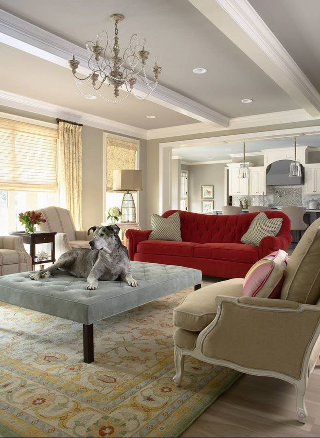 Ottoman as the Part of Modern Interior Design. Spacious living room with massive curtains and red accent sofa