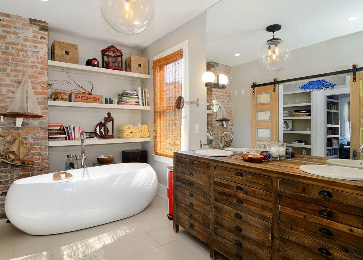 the amazing mix of almost all finishing materials and furniture within one bathroom looks organic