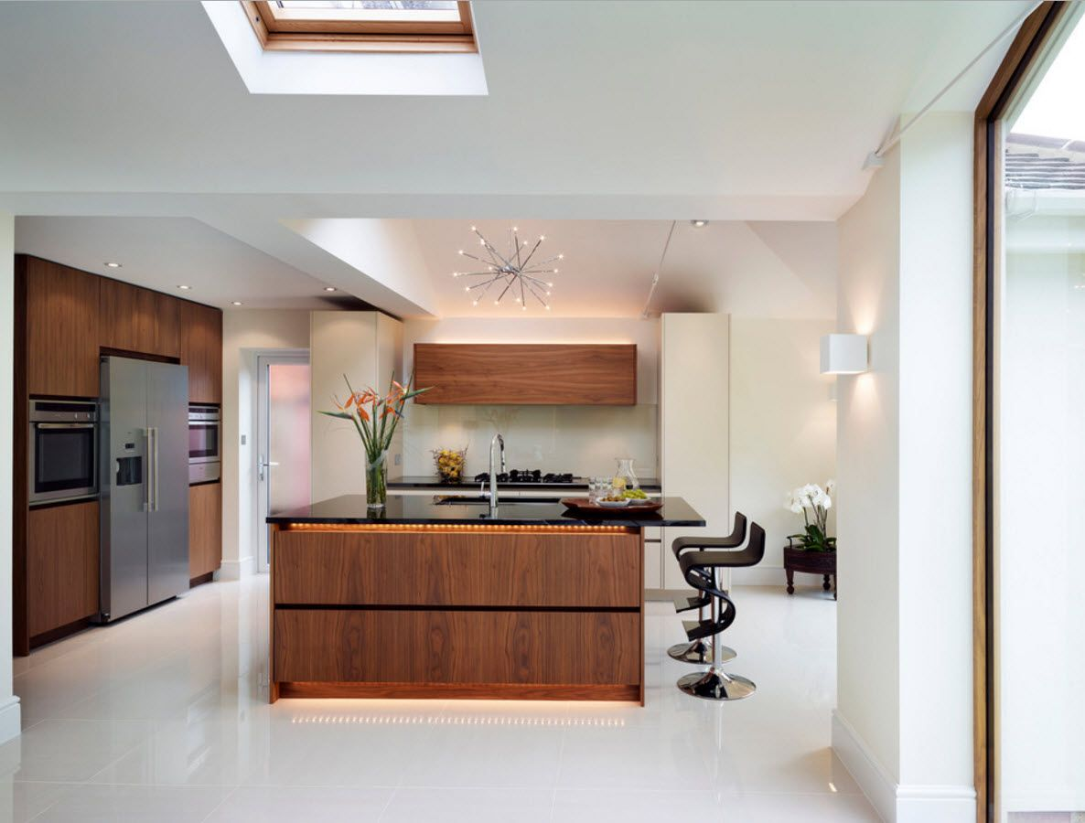 White Floor as an Exquisite Decoration Idea for Modern Interiors. Wooden furniture in the kitchen to dilute the atmosphere