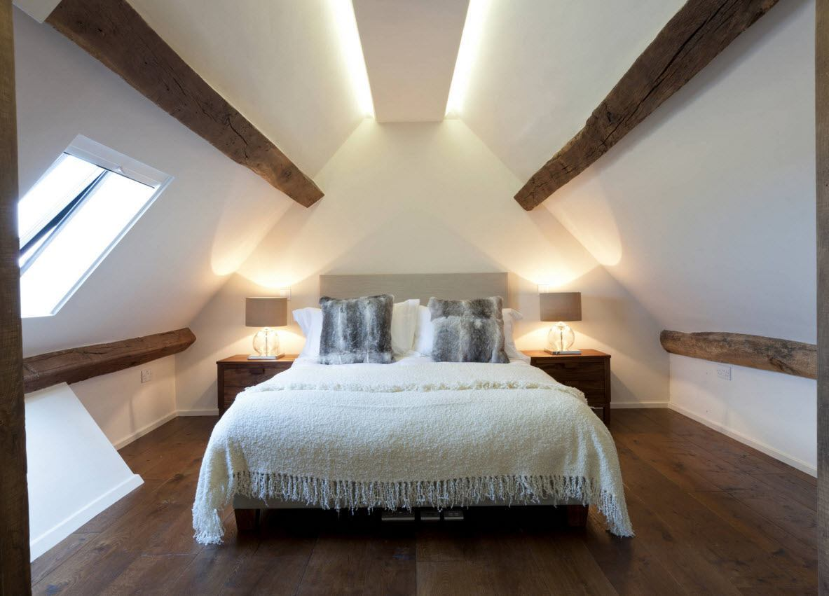 Loft Style Bedroom Design at the Attic. open Ceiling beams and backlight