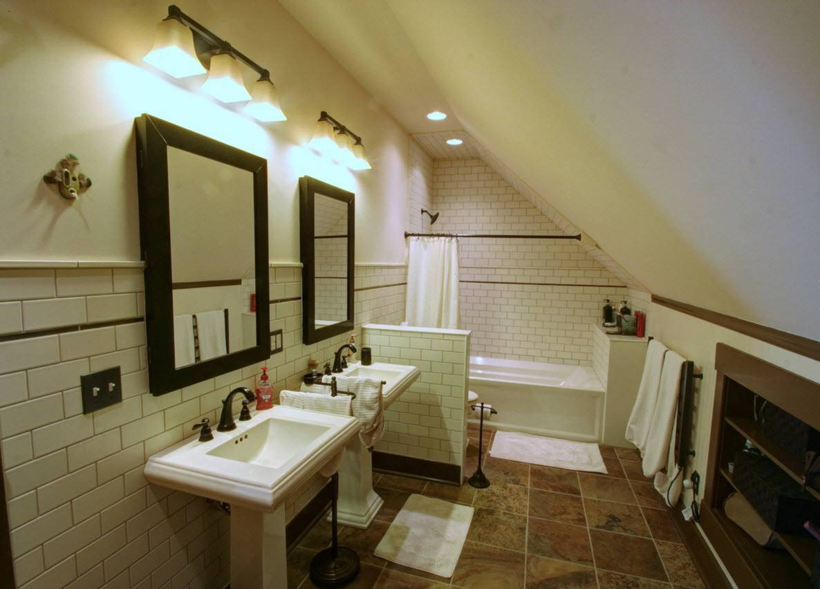 Bathroom with sloped ceiling and two sinks at the loft