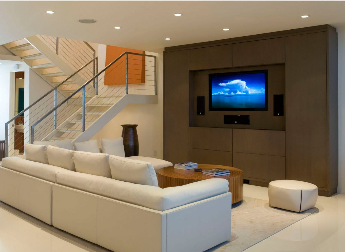 White Floor as an Exquisite Decoration Idea for Modern Interiors. Cozy home theater with brown accent wall and leather upholstered furniture