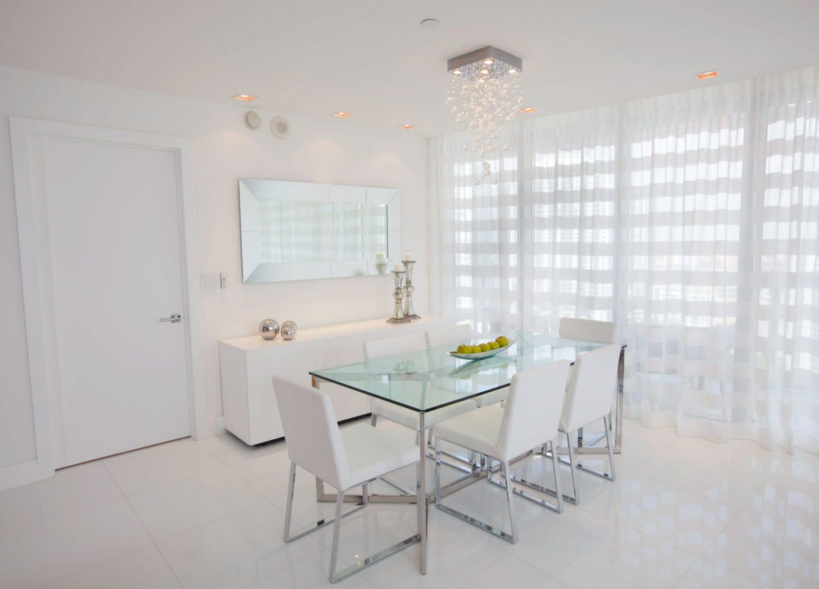 White Floor as an Exquisite Decoration Idea for Modern Interiors. Glass table and totally white chairs in the hi-tech dining room