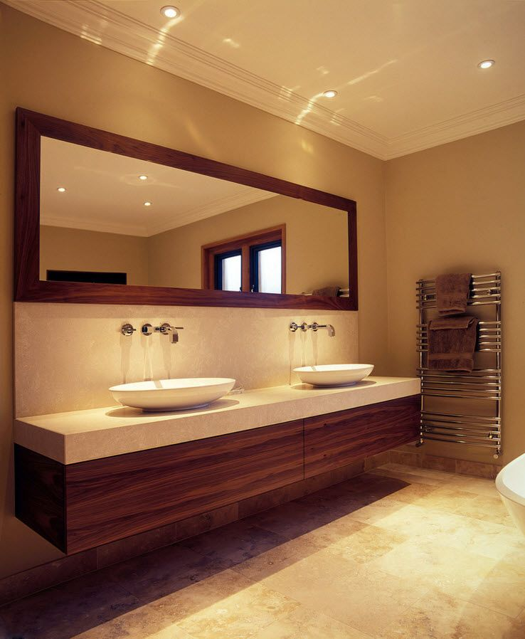walnut trimmed drawers and vanities in the bathroom