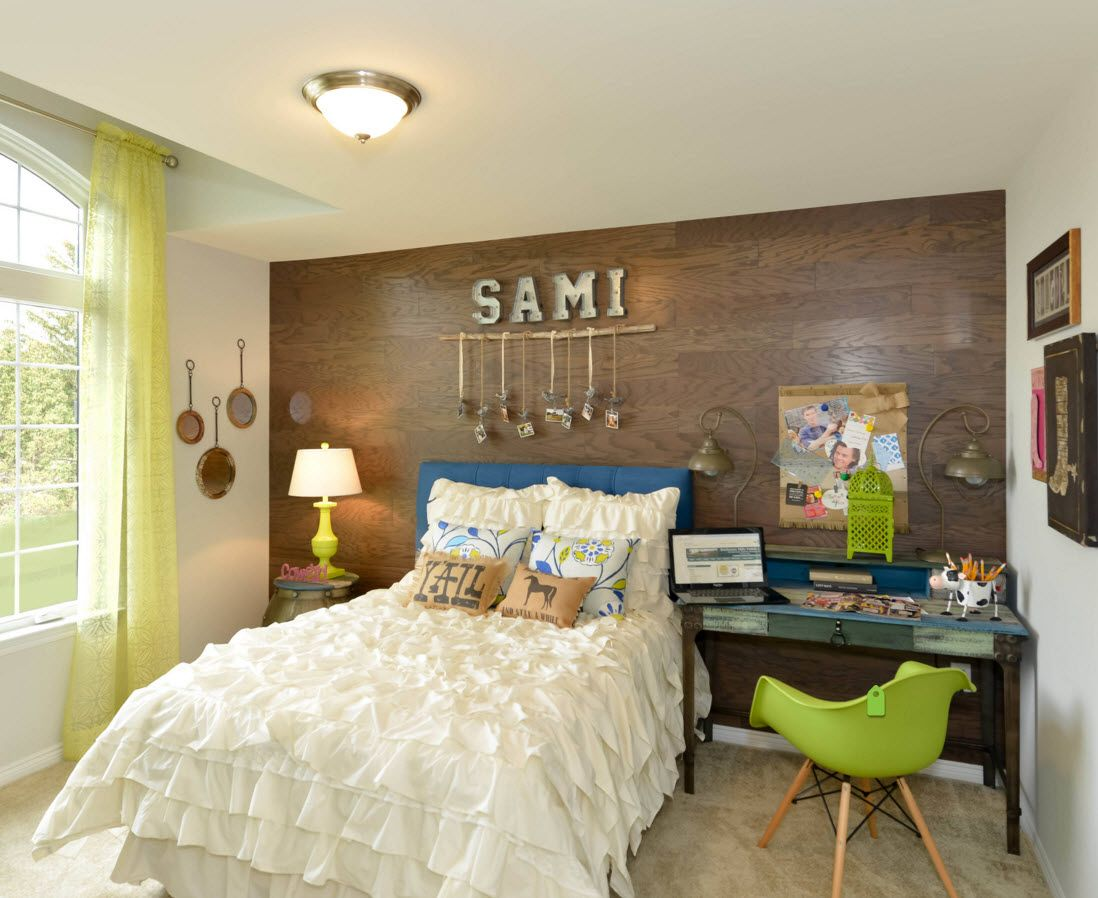 Boy's Room Design Ideas for every Age and Situation. Symbolic accent wall and the green chairs near the wooden desk