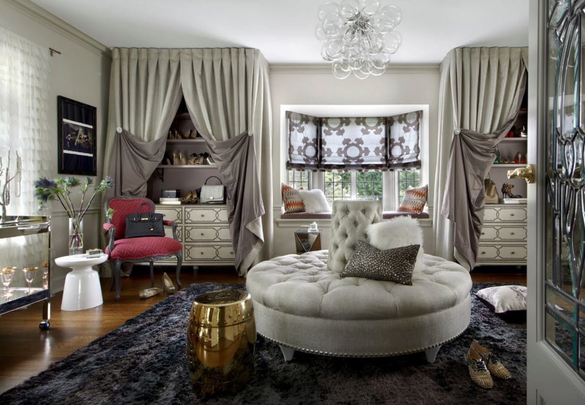 Ottoman as the Part of Modern Interior Design. Silver round quilted spectacular upholstery