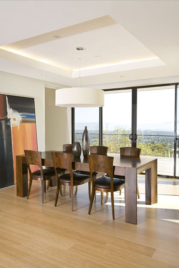 Walnut original designed chairs and the panoramic windows in the shorefront house