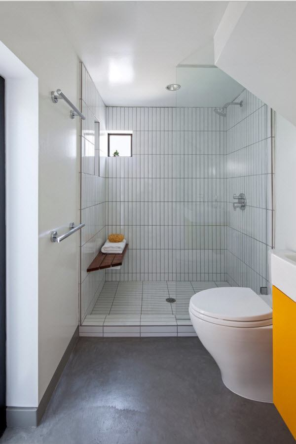 Small Grayish Toned Apartment Design Project. Austere decoration of the bathroom with metro tiles