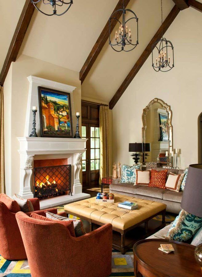 Ottoman as the Part of Modern Interior Design. Artificial fireplace and a large picture to decorate the classic living