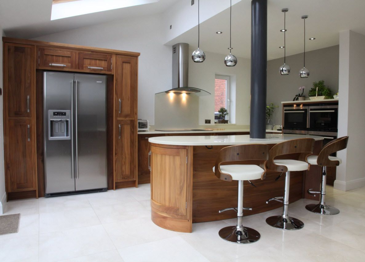 original modern decoration of the kitchen with walnut wooden units