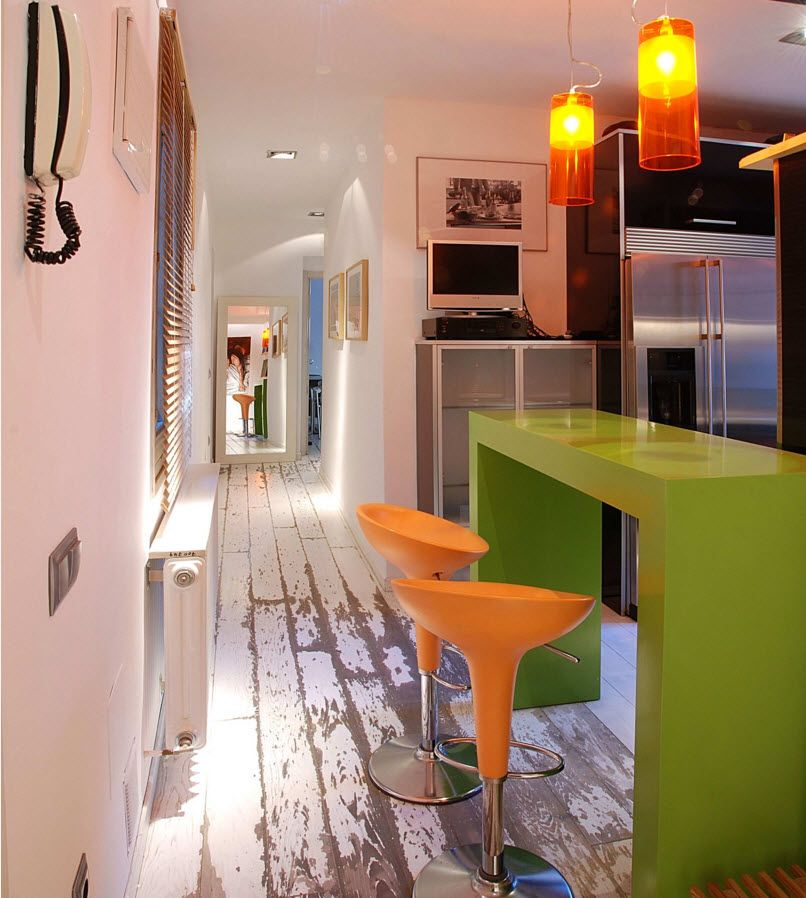 Experimental color theme in the modern fusion styled kitchen and the artificially olded floors