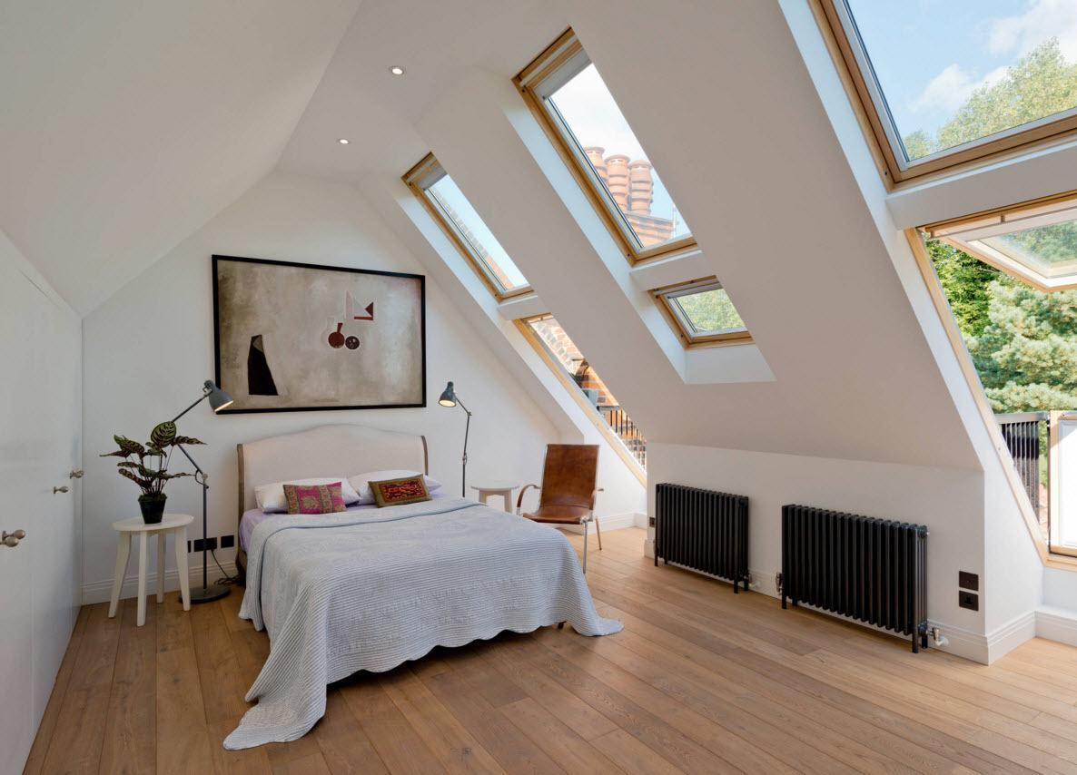 Loft Style Bedroom Design at the Attic. Narrow windows and natural trimmed floor