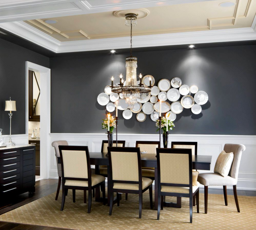 Decorative Plates on the Wall of the Dining room. Nice installation of plates on the black wall in contemporary styled dining