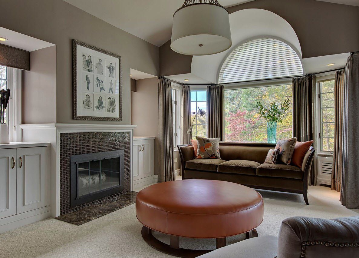 Ottoman as the Part of Modern Interior Design. hearth and gray decorated living room with brown round accent in the center