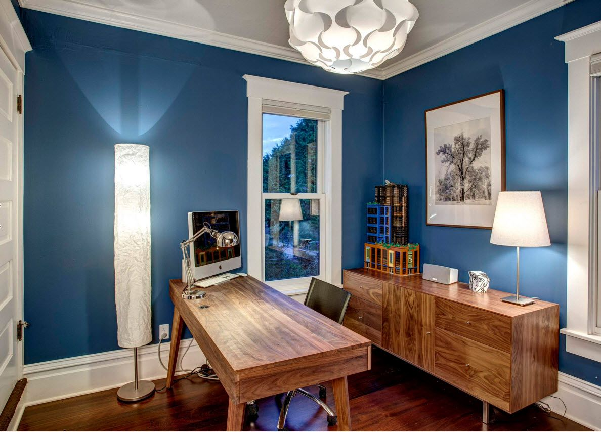 Walnut Furniture for the Modern Interior Decoration. Blue walls in the home workshop with light wooden table