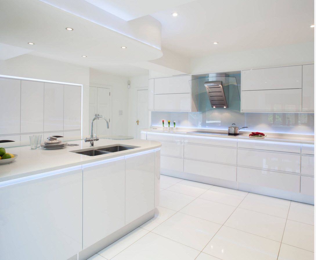 White and creamy combination of glossy kitchen surfaces in hi-tech style