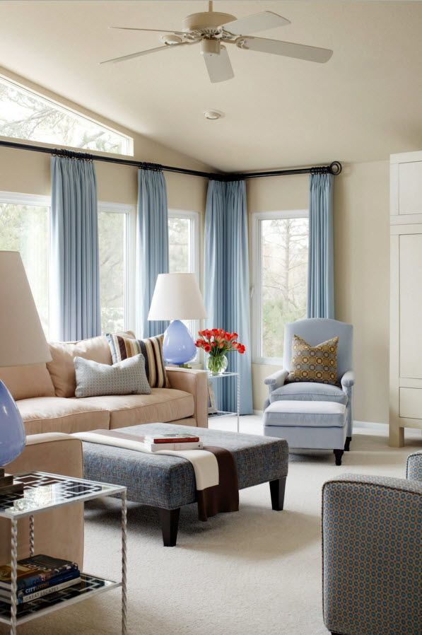 Blue curtians and ottoman as an accents in the classic designed interior of the living