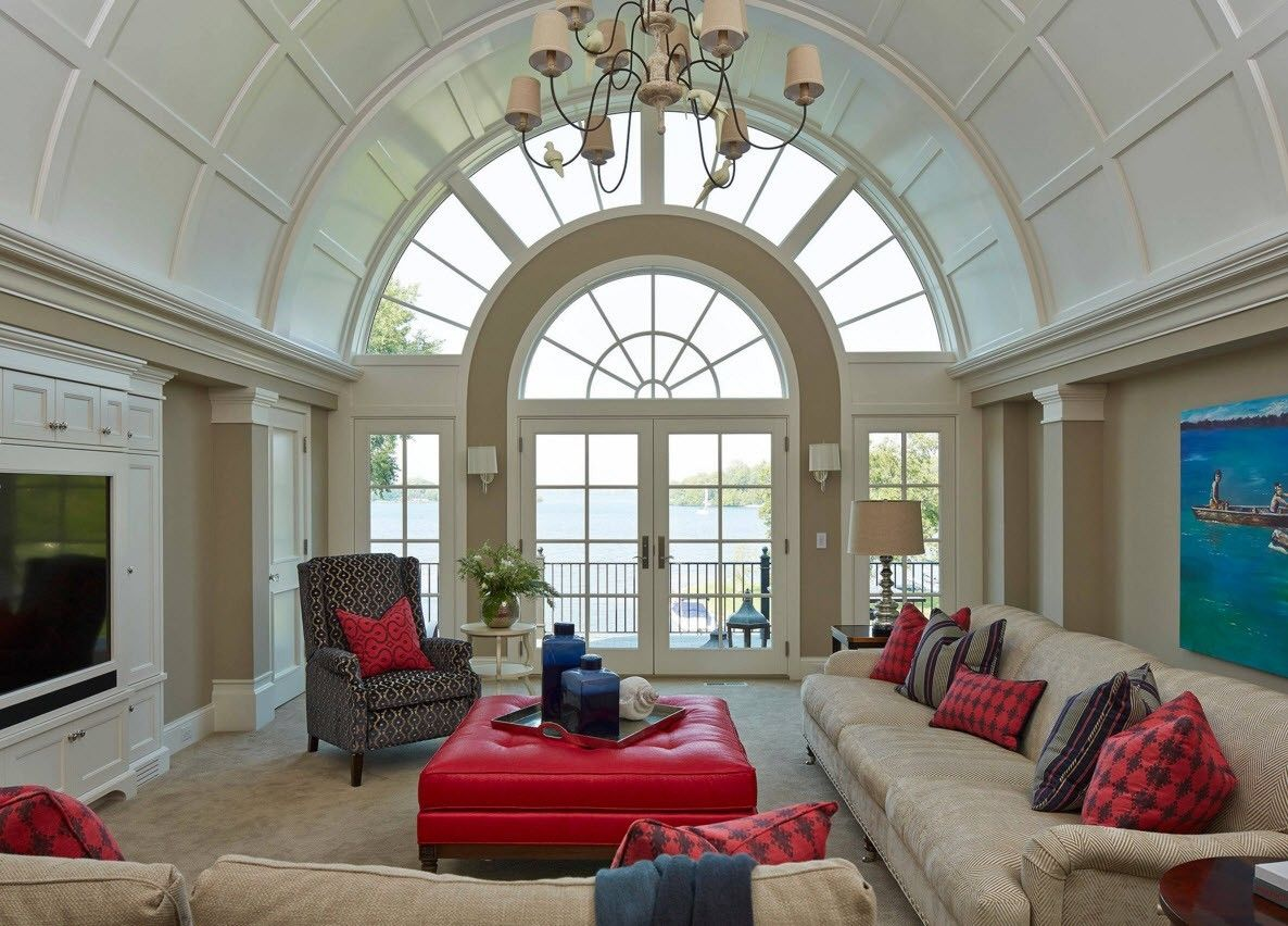 glazed lobby with the red ottoman in the center