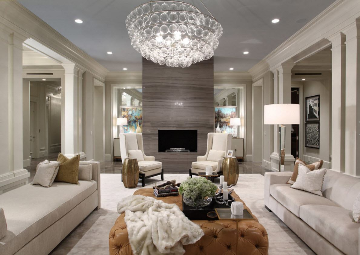 Crystal chandelier and beige ottoman are the accents of the room design