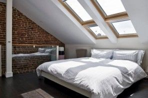 Loft Style Bedroom Design at the Attic. Double skylight construcion