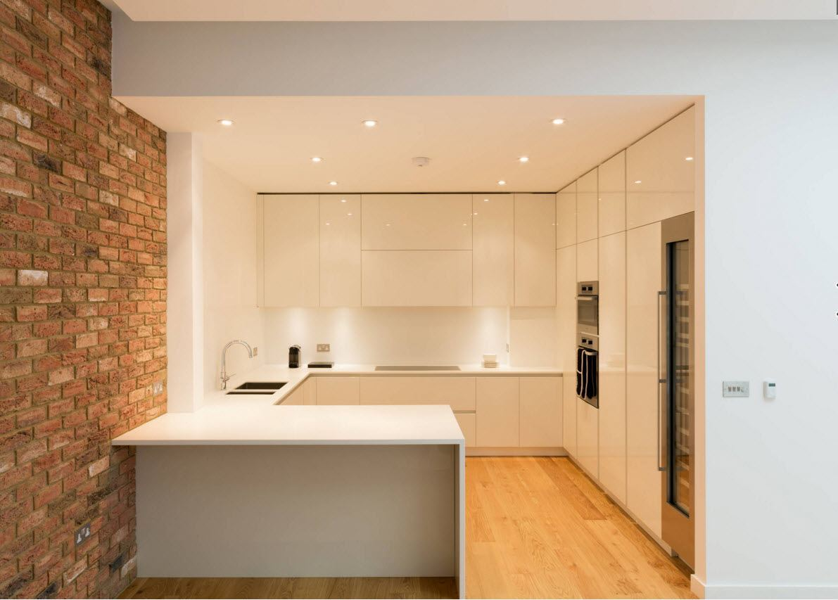 Smooth hi-tech style can be also diluted by audacious brickwork accent wall