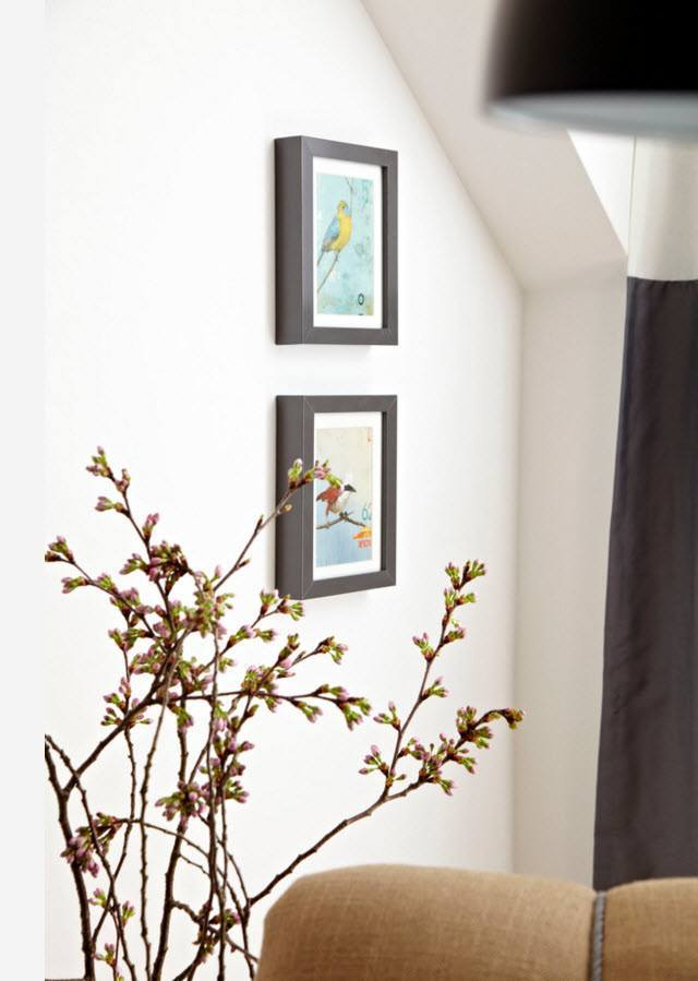 Small Apartment Light Color Design Theme. Fresh wall decor of paintings