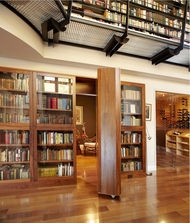 Secret Rooms with Hidden Doors Modern Design Ideas. Two-storey house with the entrance to the secret space in one of the library cabinets