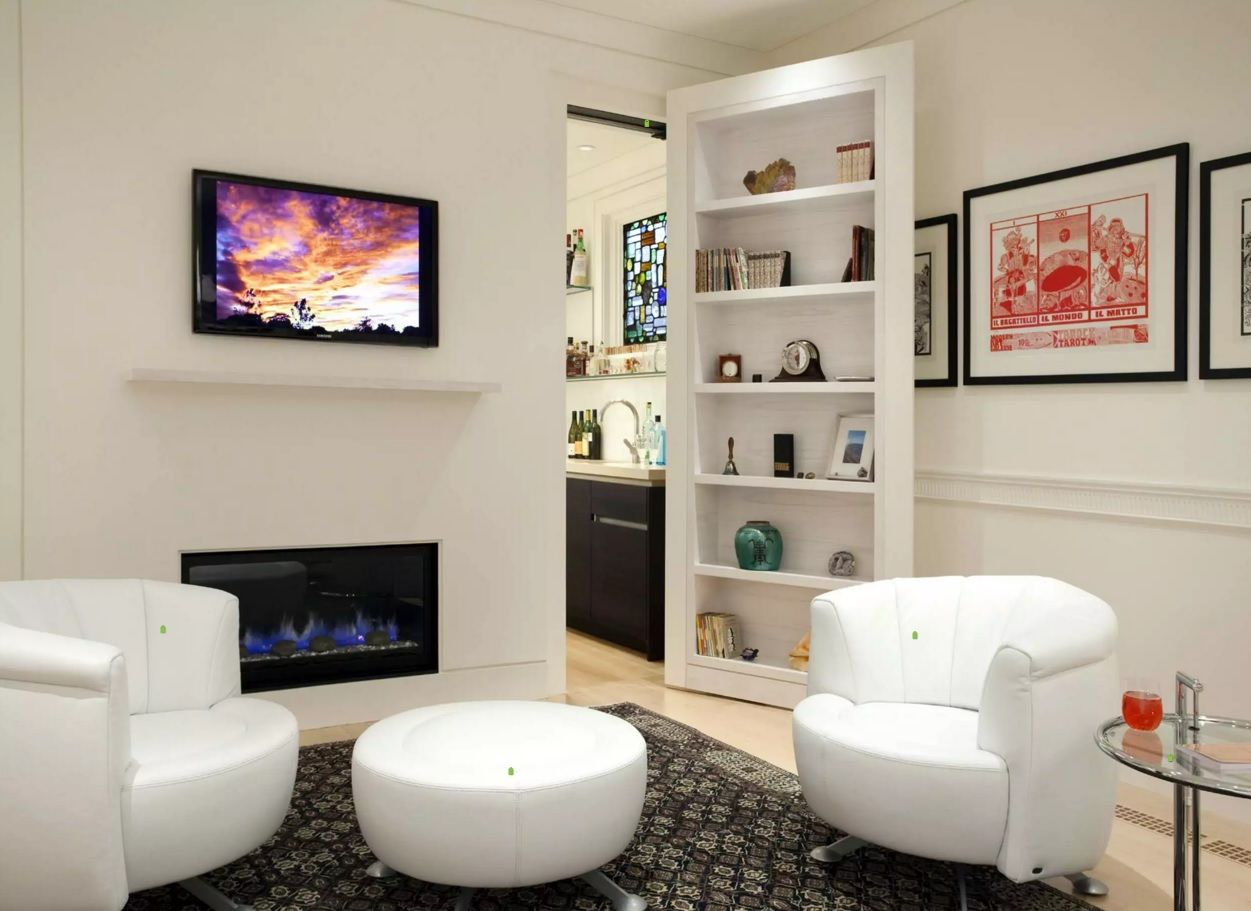 White living room in contemporary style have pass to the bathroom behind the cabinet with souvenirs